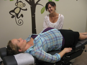 Photo of Dr. Kimberly Dawes working on a pregnant woman