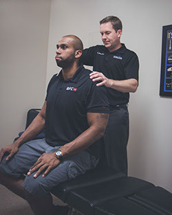 Dr. Dawes working on an athletic chiropractic patient